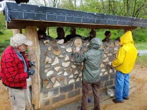 Building the cordwood sauna at the Indian Pipe Outdoor Technical School in Linden, VA.